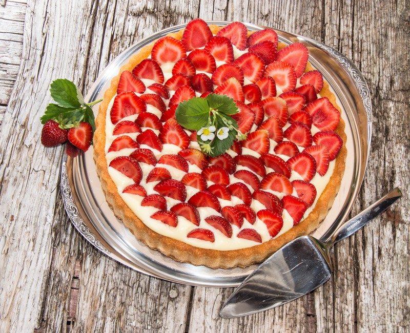 fresh-baked-strawberry-cake-on-wooden-background