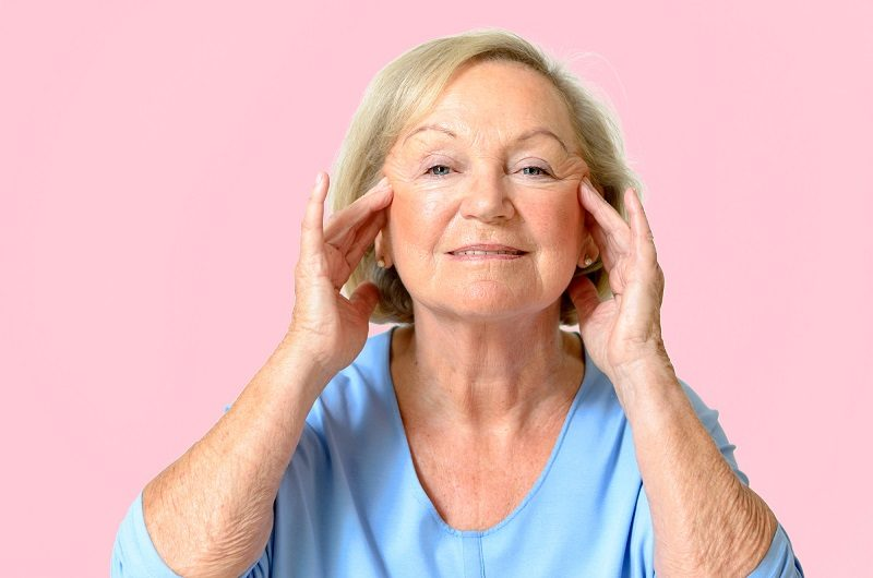 senior-woman-showing-her-face-effect-of-aging