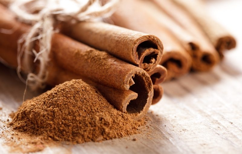 cinnamon-sticks-and-meal-close-up-on-wooden-table-2