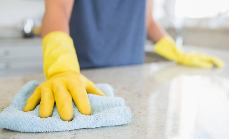 woman-cleaning-the-counter-in-the-kitchen-2