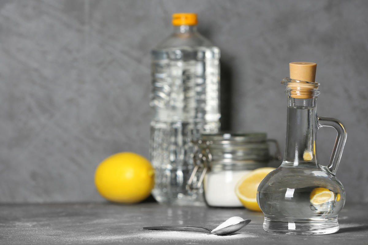 composition-with-vinegar-and-baking-soda-on-table-space-for-text