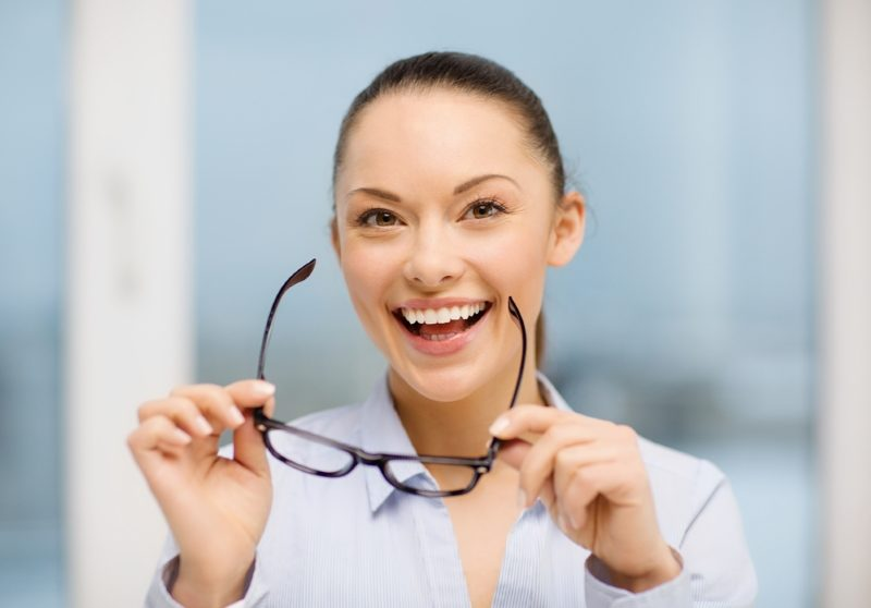 business-and-education-concept-laughing-businesswoman-with-eyeglasses