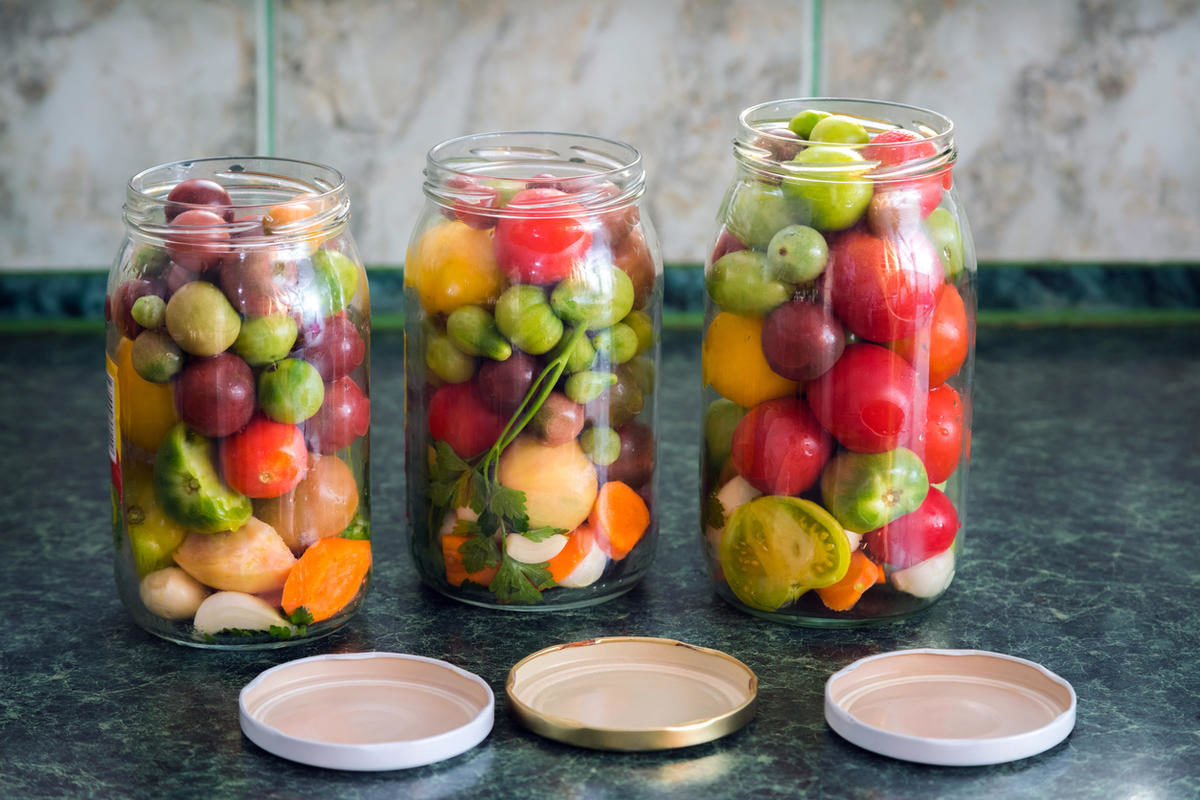 jars-of-pickled-vegetables-traditional-marinated-food-tomatoes-pickles-onions